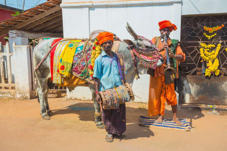 India, Goa, 15 March 2017. Musicians with a trained bull on the market Editöryel