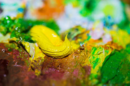Background of oil paints on a palette