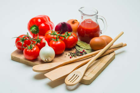 tomatoes and tomato juice on a wooden table
