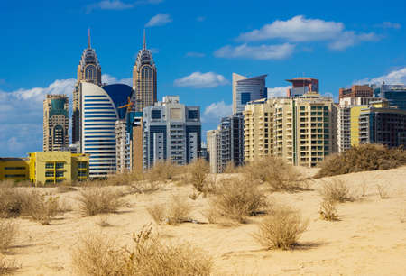 DUBAI, UAE - NOVEMBER 17: Midday heat in the desert in the background buildingsl on Nov 17, 2012 in Dubai UAE