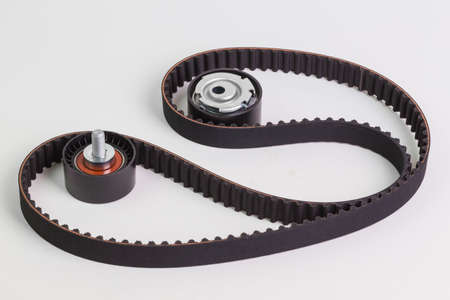 Image of timing belt with rollers on a white background Фото со стока