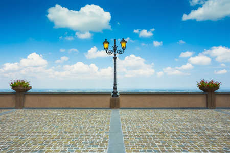 Lantern on the street of the old pavement in San Marino against the sky Stock Photo