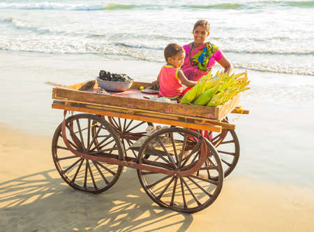India, Goa, 6 March 2017. Corn seller on the beach Goa