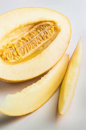 Cut ripe yellow melon on a white background 版權商用圖片