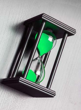 Black hourglass on black background. Close up 版權商用圖片