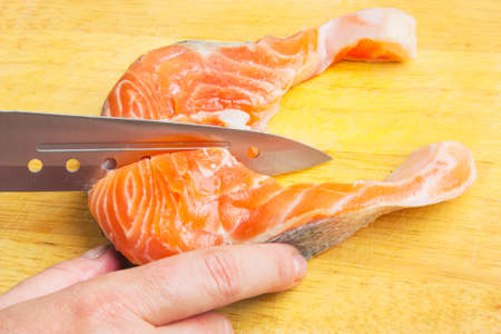 butchering of salmon on a cutting board