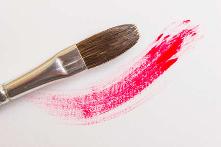 colored paints and brushes for painting on canvas and paper 版權商用圖片