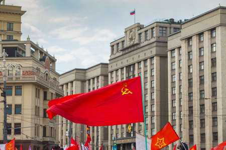 red flag on May 1 on the background of the Russian State Duma