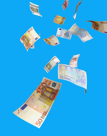 windfall: euro money raining from the sky. several euro bills isolated on blue  Stock Photo