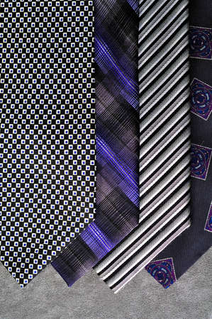 Several ties in tones of black and silver, in display, on a gray background   Stock Photo - 18516783