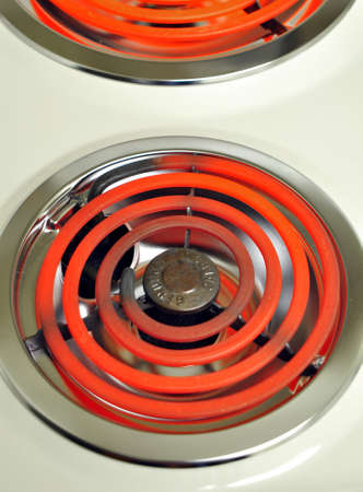 Red hot electric stove with kitchen light photo