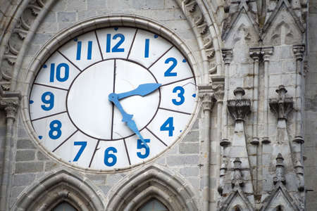 to chime: Old clock of the Basilica Church of Quito, Ecuador  Stock Photo