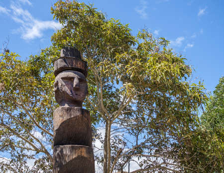 Old tribal totem in the middle of the world, Quito Ecuador photo