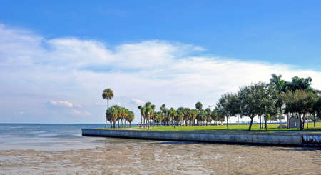 st  pete: Beach walkway with a low-tide ocean in St  Pete, Florida   Stock Photo