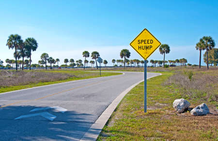 Speed Hump sign at the entrance of a beach park Stock Photo