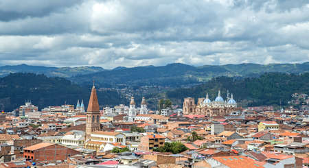 View of the city of Cuenca, Ecuador, with it s many churches, on a cloudy day 스톡 콘텐츠