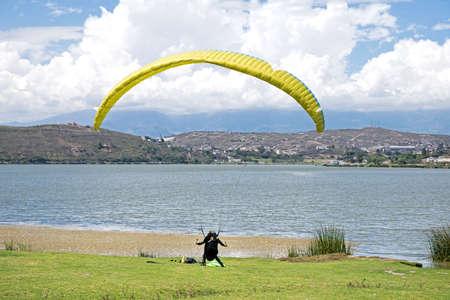 parapendio: Man testing his skydiving equipment before jumping, Ibarra, Ecuador Editorial