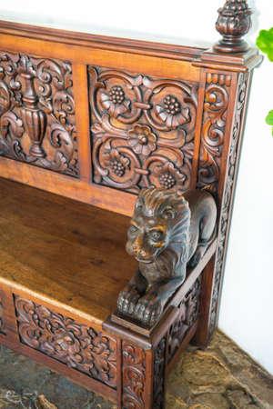 Decorative armrest of an old colonial bench, Ibarra, Ecuador photo