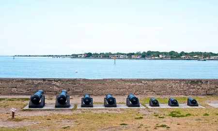 16th century: Old canons lined up in front of the bay aiming at the sea. Castillo de San Marcos, St. Augustine, Florida. 16th Century