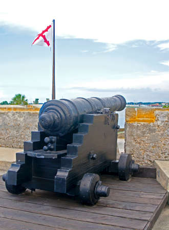 16th century: Old canon aiming at the sea on an overcast day, Castillo de San Marcos, St. Augustine, Florida, 16th century.
