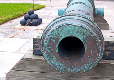 16th century: Cannon and cannonballs, in a fort, overcast day. Castillo de San Marcos, St. Augustine, Florida. 16th century.