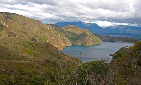 crater lake: Portion of the Cuicocha lake with its surrounding crater and mountains.