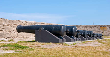 Cannons lined up on the field of the Castillo de San Marcos fort in St. Augustine, Florida.