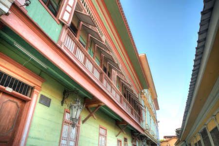 second floor: View of the second floor of some old houses and its windows, in Las Peñas neighborhood, Guayaquil, Ecuador