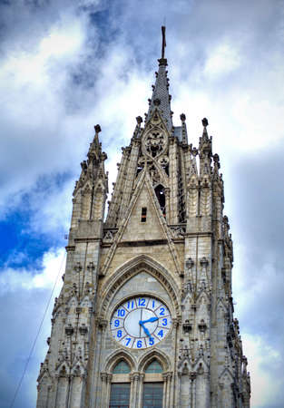 Steeple of the Basilica Church in Quito, Ecuador, at daytime, on an overcast day. Stock Photo
