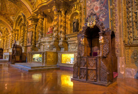Confessional booths inside the Compania church in downtown Quito, Ecuador.