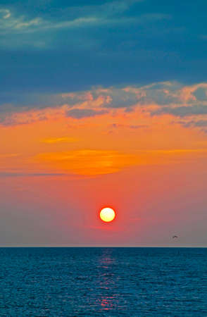 pete: View of the sun moments before sunset over the ocean of the Gulf of Mexico. Saint Petersburg, Florida, USA. Stock Photo