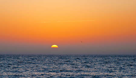 st  pete: View of the sun moments before sunset over the ocean of the Gulf of Mexico. Saint Petersburg, Florida, USA. Stock Photo