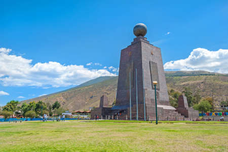 Monument at the Middle of the World, touristic attraction, north of the capital of Ecuador, Quito, on a sunny summer day Editorial