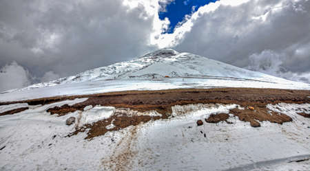 Close view of the Cotopaxi volcano, its slopes and safe house, on an overcast day. Cotopaxi National Park, Ecuador. Stock Photo