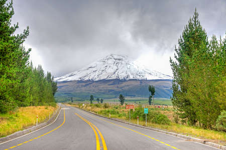 View of the Cotopaxi volcano, from the entrance to the Cotopaxi National Park, on an overcast day.