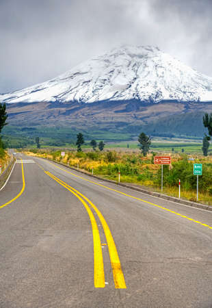 View of the Cotopaxi volcano, from the entrance to the Cotopaxi National Park, on an overcast day. Stock Photo