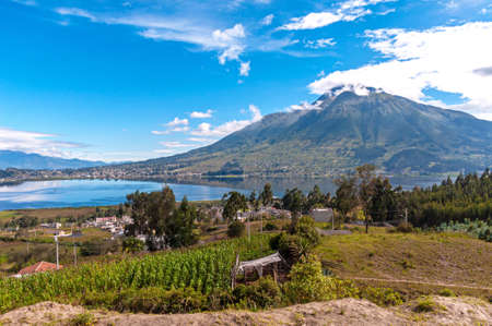 Beautiful view of the Imbabura volcano, the San Pablo lake and green fields, on a beautiful day. Ecuador, South America