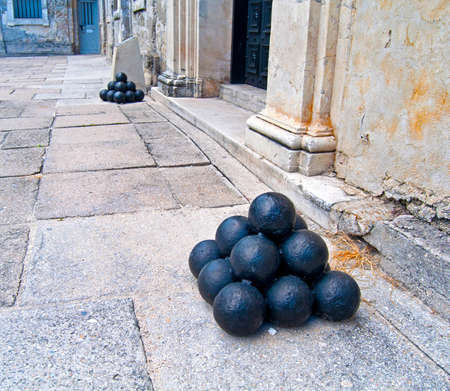 Metal cannon ball bullets in a bunch, on display at the old Castillo de San Marcos fort, in Saint Augustine