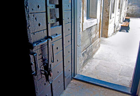 Old fort door and interior patio in the background, of the Castillo de San Marcos fort in Saint Augustine