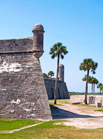 Castillo de San Marcos fort and field, with cannons, palm trees and a blue sky. Saint Augustine