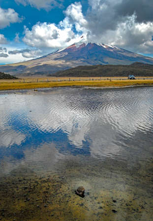 View of the Limpiopungo lagoon with the Cotopaxi volcano in the background on a cloudy and overcast afternoon - Ecuador Stock Photo