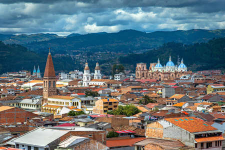 View of the city of Cuenca, with it's many churches, cathedrals and houses, in the middle of the Ecuadorian Andes, on a sunny afternoon, Ecuador, South America.