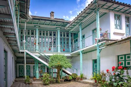 Guaranda, Bolivar province, Ecuador - November, 2013: An old colonial and traditional house, with many doors, hallways, windows, balconies and interior patios. Editorial