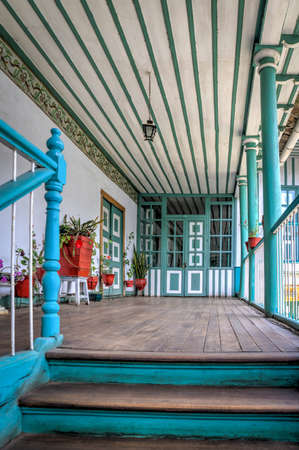 Guaranda, Bolivar province, Ecuador - November, 2013: An old colonial and traditional house, with many doors, hallways, windows, balconies and interior patios.
