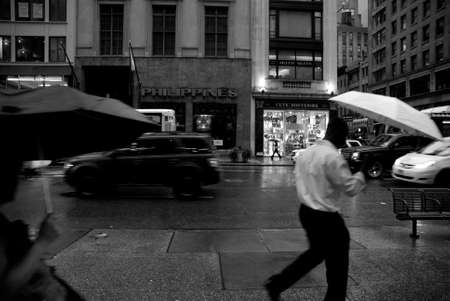 rainy day: Walking under the rain in New York City Stock Photo
