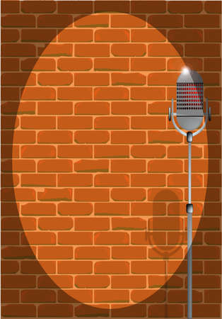 comedy: A microphone ready on stage against a brick wall