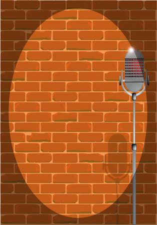 Un micrófono en el escenario preparado contra una pared de ladrillo