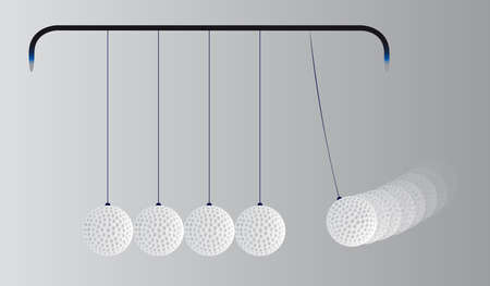 A kinetic energy cradle loaded with five golf balls.