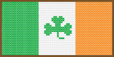 A cross stitch version of the flag of Ireland with a shamrock, with a frame.. Vector