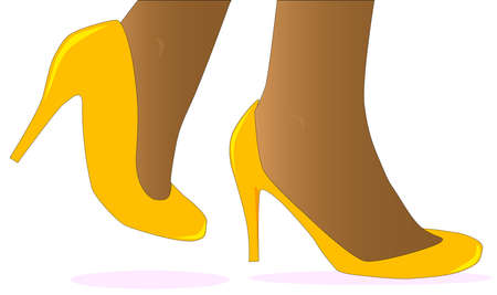 heals: A pair of ladies ankles wearing yellow shoes